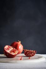 Split Pomegranate On A Marble Board.