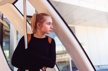 Teenage Girl Looking Out A Train Window