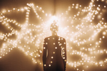 Silhouette Of A Woman In Lights