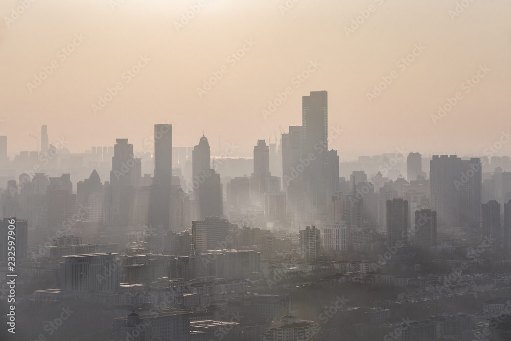 Nanjing, China. Severe air pollution, haze and poor visibility make the tall buildings in the city hard to see clearly