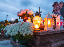 Candles Burning At A Cemetery During All Saints Day.