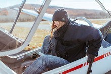 Woman Ready To Take Flight In A Glider Plane