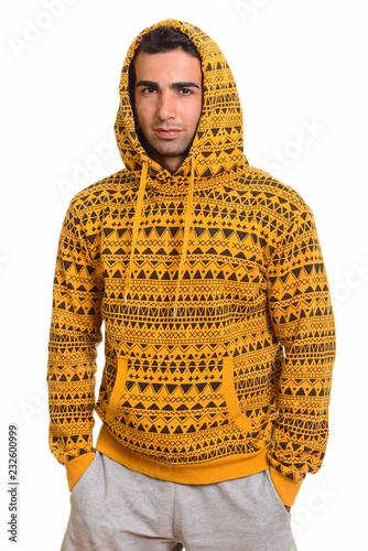 Fotografía  Portrait of young handsome Persian man wearing hoodie