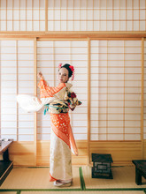 Asian Woman In Traditional Kimono Clothing