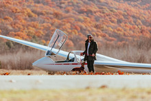 Friends Gathered On Airfield, Taking Turns Flying Gliders In Upstate New York