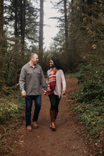 Couple Walking Together On Path In Woods