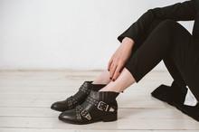 Woman Wearing Stylish Leather Boots. Close Up.