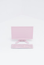 Pink PC And Keyboard In White Space
