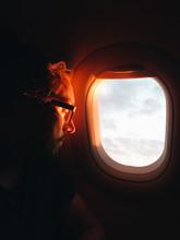 Man Looking Through Plane Window