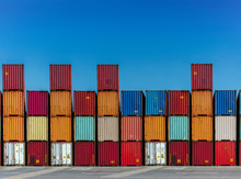Stacked Cargo Containers In Storage Area Of Freight Sea Port Terminal