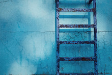 Rusty Ladder In A Old Swimming...