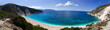 Beautiful Myrtos beach with clear turquoise water on a sunny day in the Ionian Sea on the island of Kefalonia in Greece