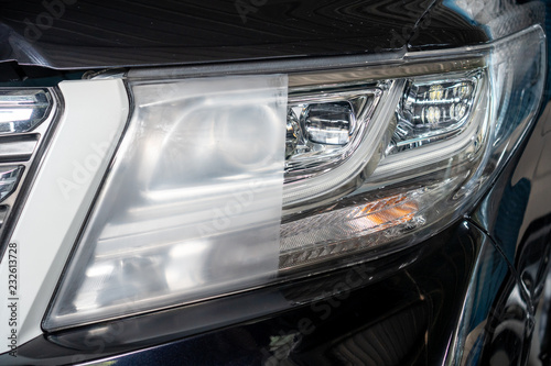 Obraz Car headlights with power buffer machine at service station - a series of CAR CARE images. - fototapety do salonu