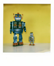 Polaroid Scan Of Two Retro Style Robots