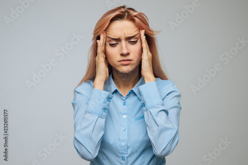 Pressure, strong migraine, feeling dizzy concept. Portrait of attractive tired stressful woman has a headache, tries to concentrate, gather with thoughts, keeps hands on temples, isolated.