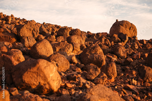 Desert landscape with small stones on large one