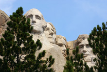 Close-up Of The 4 Presidents Commemorated By Mount Rushmore.