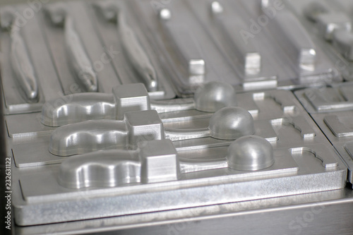 Fotografía  Metal mold for plastic toothbrush mold parts, images with small depth of field