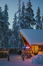 Illuminated Cafe In Snowy Coun...
