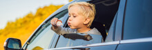 Boy Blowing Bubbles In The Car...