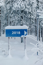 Direction Sign 2018 In Snowy Woods