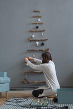 Woman Decorating Minimal Handmade Christmas Tree