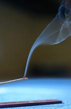 Burning Incense And Swirling Smoke