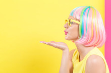 Woman In A Colorful Wig Blowin...