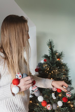 A Teenager Decorating Her Christmas Tree