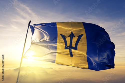 Barbados Barbadian flag textile cloth fabric waving on the top sunrise mist fog Canvas Print