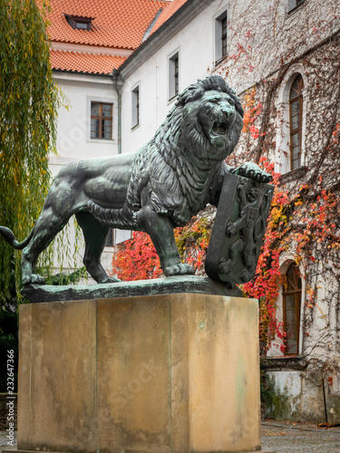 Fotografie, Obraz  Bronze sculpture of lion on the yard of Strahov Monastery