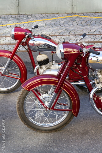 Fototapeta Red vintage motorcycles Jawa 125 and Jawa 500 produced in former Czechoslovakia stand on road obraz
