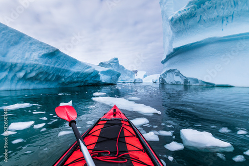 Poster Antarctique Kayaking in Antarctica between icebergs with inflatable kayak, extreme adventure in Antarctic Peninsula , beautiful pristine landscape, sea water paddling activity