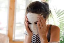 Teen Removing Plaster Mask