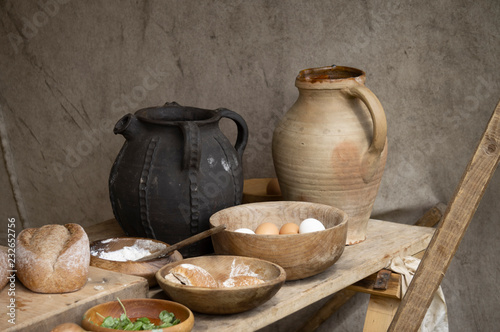 Canvas Print Early medieval Saxon type pots and wooden bowls with ingredients in