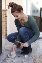Woman Crushing Tiles For Mosai...
