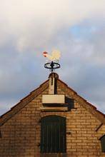 Close-up Of A Weather Vane On Top Of A Shed's Roof