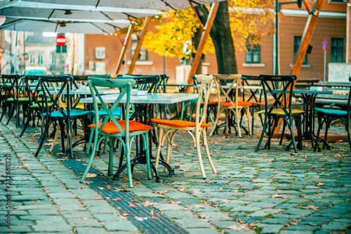 Photo  European restaurant summer terrace with beautiful colorful vintage chairs
