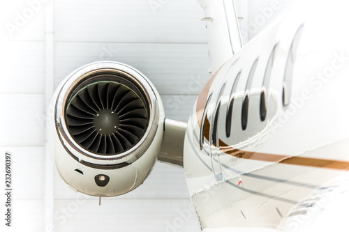 Foto High detailed closeup view on small white private business jet windows engine