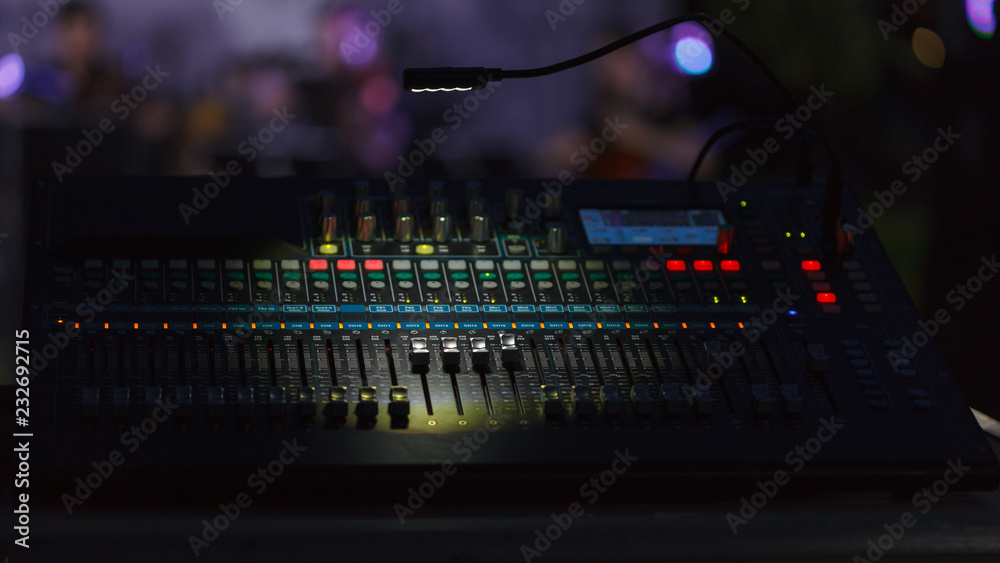 Fotografie, Obraz Front view to the working mixing console, an electronic device for changing the