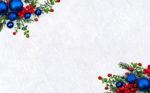 Christmas Decoration. Frame Of Twigs Christmas Tree, Christmas Blue Balls And Red Berries On Snow With Space For Text. Top View, Flat Lay