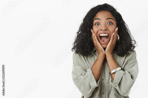 Portrait of upbeat enthusiastic and delighted surprised dark-skinned girlfriend Canvas Print