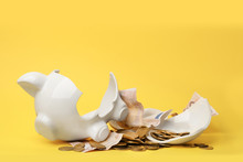 Broken Piggy Bank With Money On Color Background