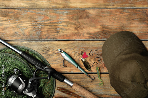 Foto op Aluminium Jacht Flat lay composition with fishing equipment and space for text on wooden background