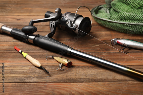Fishing tackle on wooden table. Recreational activity