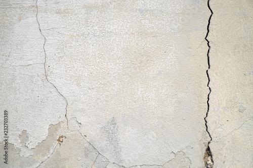 Fototapeta Old foundation and plaster wall with cracks. Building requiring repair closeup. obraz