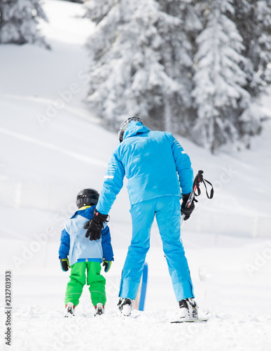 Child with teacher learning skiing