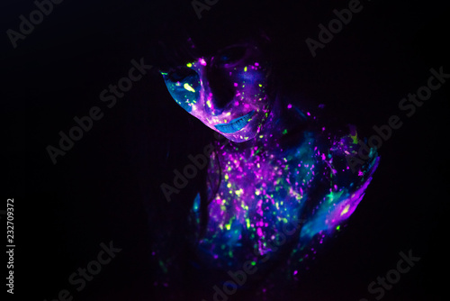 Bodypainting on nude girl painted with UV colors Poster Mural XXL