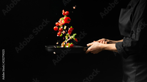Fototapeta Chef preparing vegetables on a dark background on a grill pan obraz