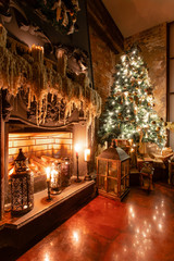 Fototapeta na wymiar Winter home decor. Christmas in loft interior against brick wall. gifts under the tree. star lamp with light bulbs. lights garlands